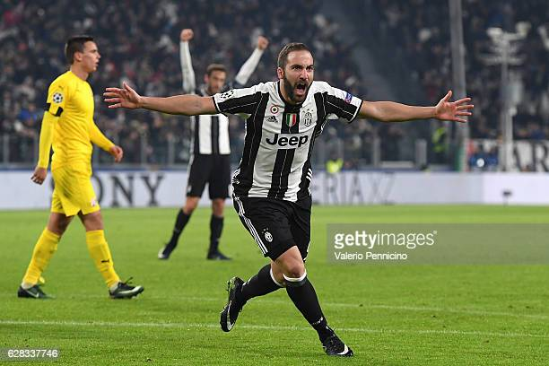 Gonzalo Higuain of Juventus celebrates after scoring the opening goal during the UEFA Champions League Group H match between Juventus and GNK Dinamo...