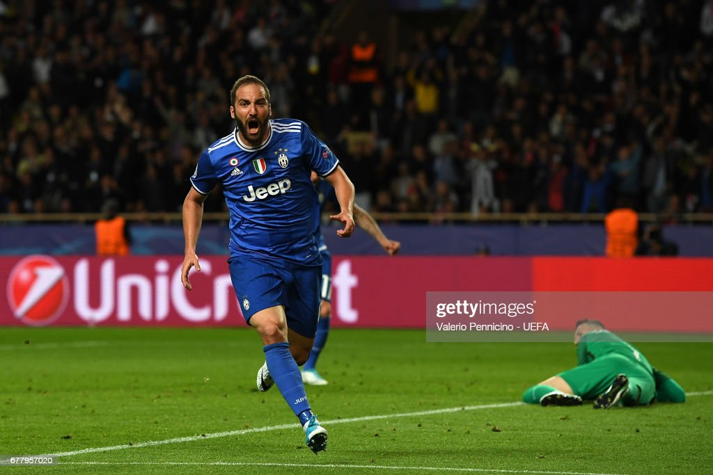 Gonzalo Higuain of Juventus celebrates after scoring the opening goal during the UEFA Champions League Semi Final first leg match between AS Monaco v Juventus at Stade Louis II on May 3, 2017 in Monaco, Monaco.