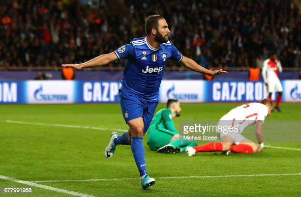 Gonzalo Higuain of Juventus celebrates scoring his sides second goal during the UEFA Champions League Semi Final first leg match between AS Monaco v...