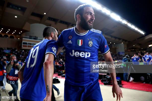 Gonzalo Higuain of Juventus celebrates with Leonardo Bonucci after scoring his sides first goal during the UEFA Champions League Semi Final first leg...