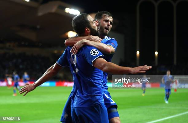 Gonzalo Higuain of Juventus celebrates with Miralem Pjanic after scoring his sides second goal during the UEFA Champions League Semi Final first leg...