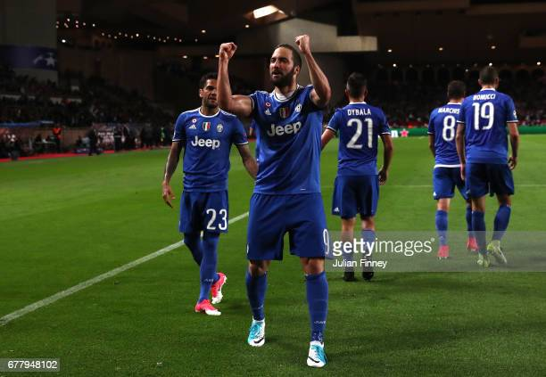 Gonzalo Higuain of Juventus celebrates with team mates after scoring his sides first goal during the UEFA Champions League Semi Final first leg match...