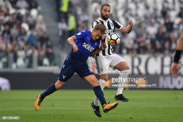 Gonzalo Higuain of Juventus competes for the ball during the Serie A match between Juventus and SS Lazio on October 14 2017 in Turin Italy