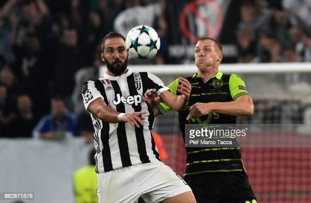 Gonzalo Higuain of Juventus competes for the ball with Jeremy Mathieu of Sporting CP during the UEFA Champions League group D match between Juventus...
