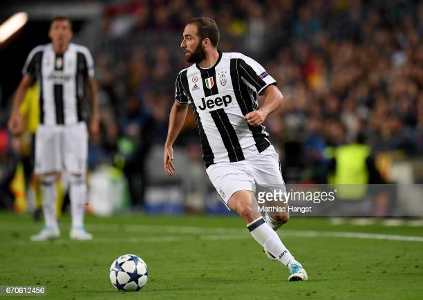 Gonzalo Higuain of Juventus controls the ball during the UEFA Champions League Quarter Final second leg match between FC Barcelona and Juventus at...