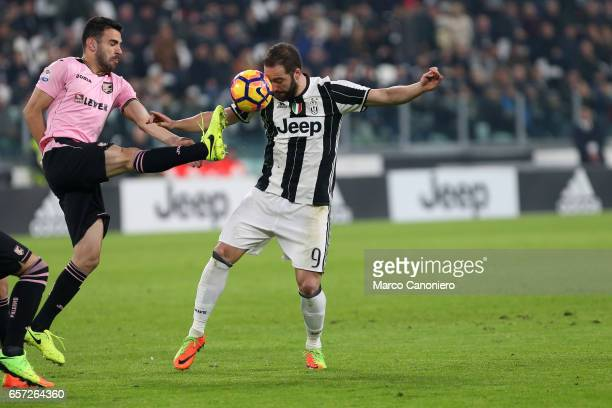 Gonzalo Higuain of Juventus Fc and Bruno Henrique of Us Palermo battel for the ball during the Serie A match between Juventus FC and US Palermo at...