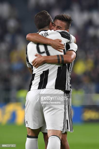 Gonzalo Higuain of Juventus FC celebrates after scoring the opening goal with team mate Paulo Dybala during the Serie A match between Juventus FC and...