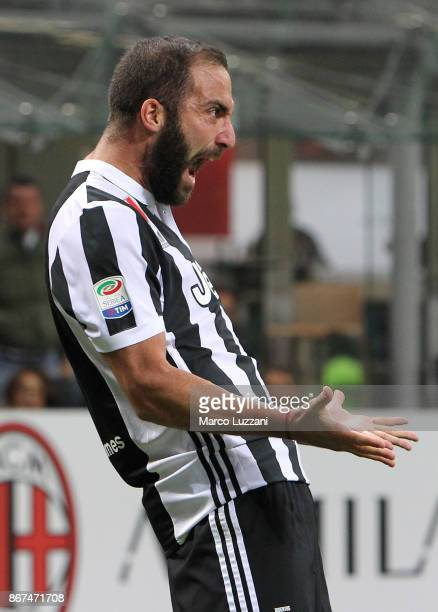 Gonzalo Higuain of Juventus FC celebrates after scoring the opening goal during the Serie A match between AC Milan and Juventus at Stadio Giuseppe...