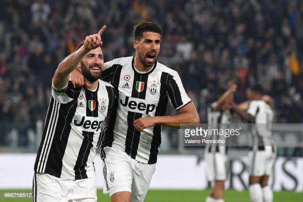 Gonzalo Higuain of Juventus FC celebrates his second goal with team mate Sami Khedira during the Serie A match between Juventus FC and AC...