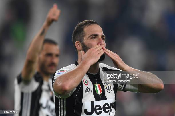 Gonzalo Higuain of Juventus FC celebrates victory at the end of the Serie A match between Juventus FC and AC ChievoVerona at Juventus Stadium on...