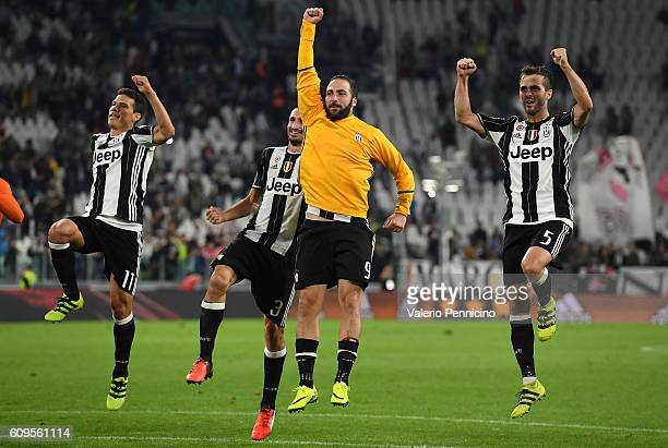 Gonzalo Higuain of Juventus FC celebrates victory with team mates at the end of the Serie A match between Juventus FC and Cagliari Calcio at Juventus...