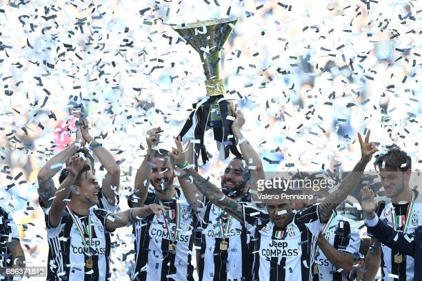 Gonzalo Higuain of Juventus FC celebrates with the trophy after beating FC Crotone 30 to win the Serie A Championships at the end of the Serie A...