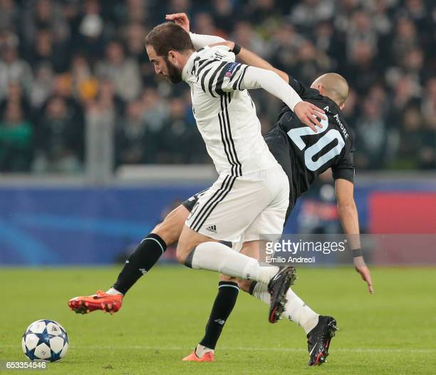 Gonzalo Higuain of Juventus FC competes for the ball with Andre Andre of FC Porto during the UEFA Champions League Round of 16 second leg match...