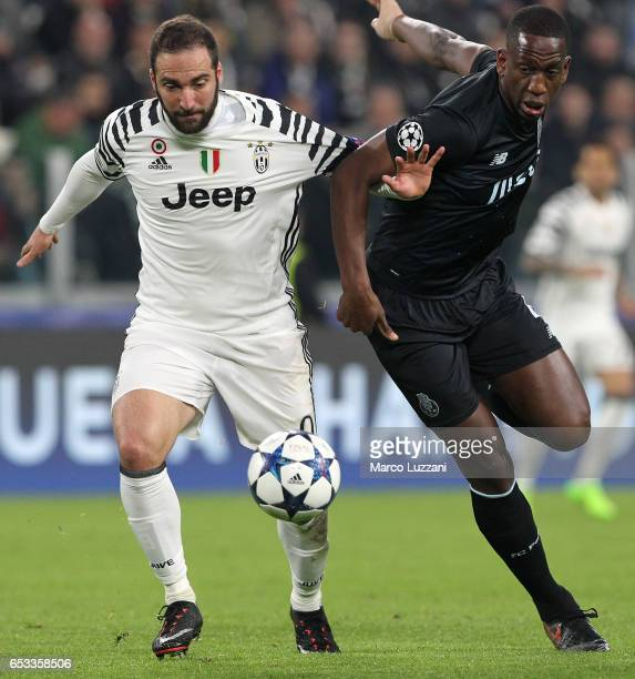 Gonzalo Higuain of Juventus FC competes for the ball with Danilo of FC Porto during the UEFA Champions League Round of 16 second leg match between...