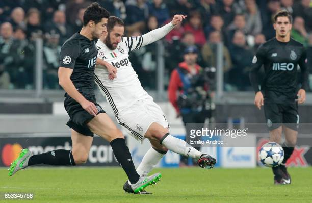 Gonzalo Higuain of Juventus FC competes for the ball with Ivan Marcano of FC Porto during the UEFA Champions League Round of 16 second leg match...