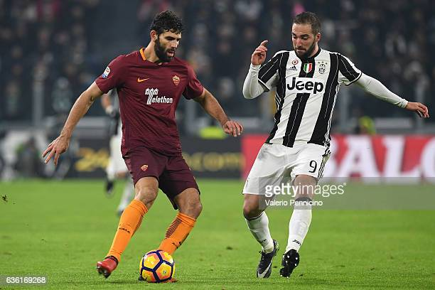 Gonzalo Higuain of Juventus FC competes with Federico Fazio of AS Roma during the Serie A match between Juventus FC and AS Roma at Juventus Stadium...