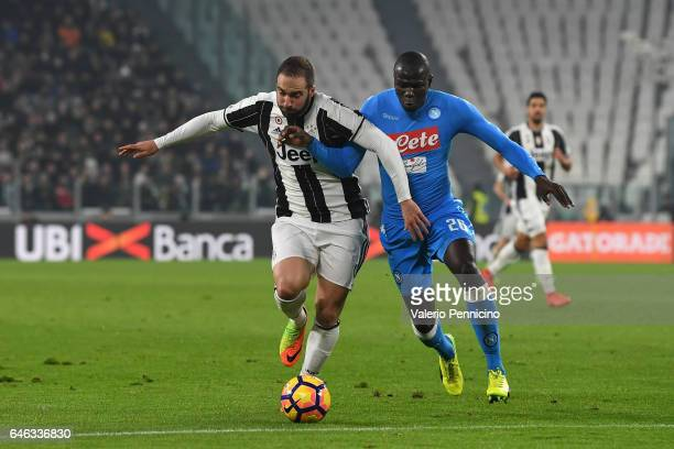 Gonzalo Higuain of Juventus FC competes with Kalidou Koulibaly of SSC Napoli during the TIM Cup match between Juventus FC and SSC Napoli at Juventus...