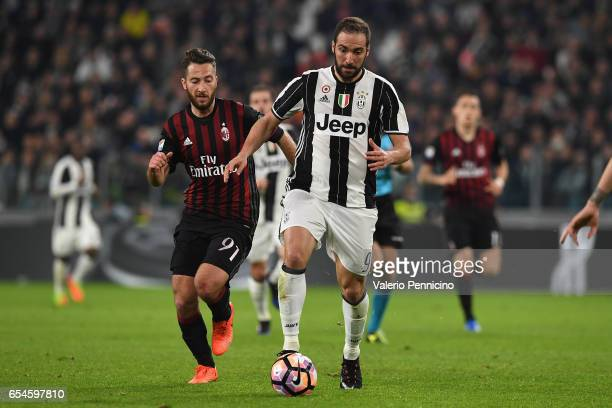 Gonzalo Higuain of Juventus FC in action against Andrea Bertolacci of AC Milan during the Serie A match between Juventus FC and AC Milan at Juventus...