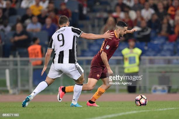 Gonzalo Higuain of Juventus FC in action against Costas Manolas of AS Roma during Italian Serie A soccer match between AS Roma and Juventus FC at...