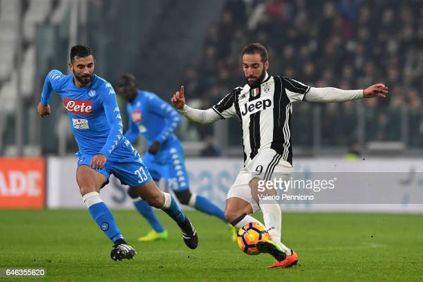 Gonzalo Higuain of Juventus FC in action against Raul Albiol of SSC Napoli during the TIM Cup match between Juventus FC and SSC Napoli at Juventus...