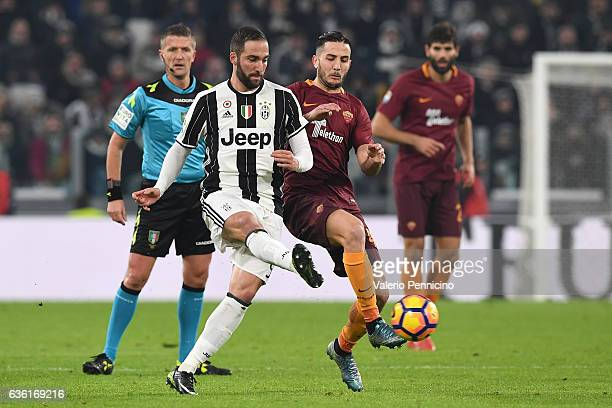 Gonzalo Higuain of Juventus FC is challenged by Konstantinos Manolas of AS Roma during the Serie A match between Juventus FC and AS Roma at Juventus...