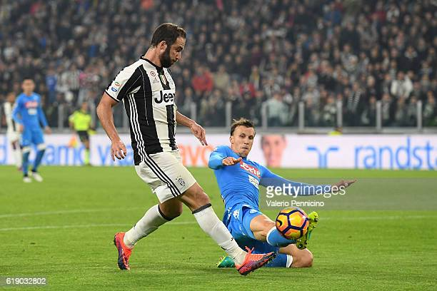 Gonzalo Higuain of Juventus FC is challenged by Vlad Iulian Chiriches of SSC Napoli during the Serie A match between Juventus FC and SSC Napoli at...