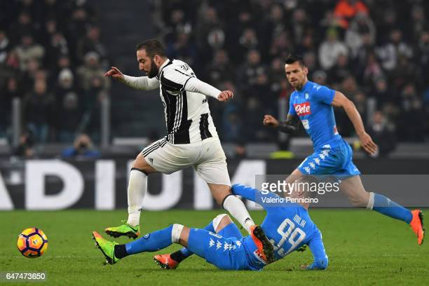 Gonzalo Higuain of Juventus FC is tackled by Arkadiusz Milik of SSC Napoli during the TIM Cup match between Juventus FC and SSC Napoli at Juventus...