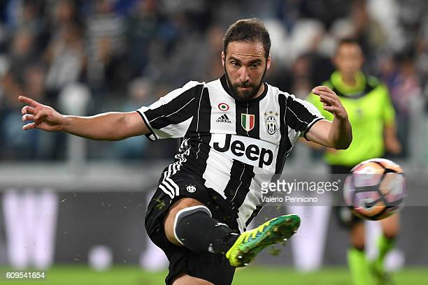 Gonzalo Higuain of Juventus FC kicks the ball during the Serie A match between Juventus FC and Cagliari Calcio at Juventus Stadium on September 21...