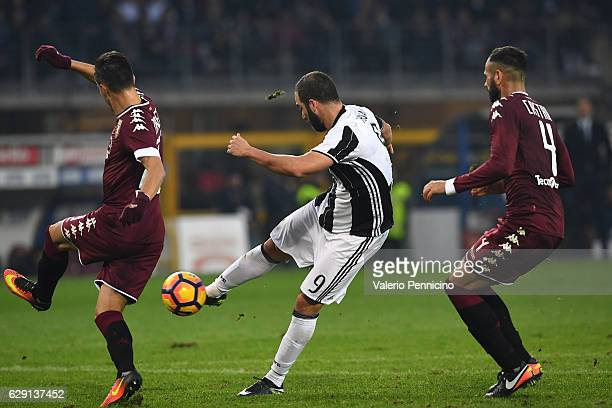 Gonzalo Higuain of Juventus FC scores his second goal during the Serie A match between FC Torino and Juventus FC at Stadio Olimpico di Torino on...