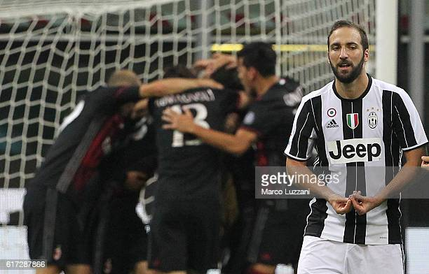 Gonzalo Higuain of Juventus FC shows his dejection at the end of the Serie A match between AC Milan and Juventus FC at Stadio Giuseppe Meazza on...