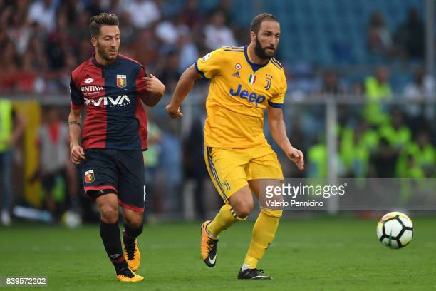 Gonzalo Higuain of Juventus in action against Andrea Bertolacci of Genoa CFC during the Serie A match between Genoa CFC and Juventus at Stadio Luigi...