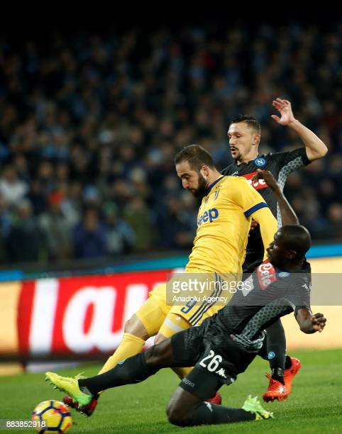 Gonzalo Higuain of Juventus in action against Kalidou Koulibaly of SSC Napoli during the Serie A football match between SSC Napoli and FC Juventus at...