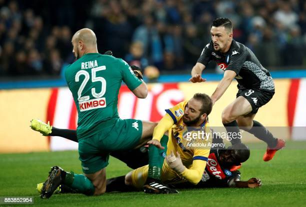Gonzalo Higuain of Juventus in action against Pepe Reina Mario Rui and Kalidou Koulibaly of SSC Napoli during the Serie A football match between SSC...
