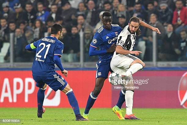 Gonzalo Higuain of Juventus is challenged by Mouctar Diakhaby of Olympique Lyonnais during the UEFA Champions League Group H match between Juventus...
