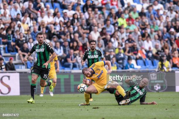 Gonzalo Higuain of Juventus is challenged by Paolo Cannavaro of Sassuolo during the Serie A match between Sassuolo and Juventus at Mapei Stadium...