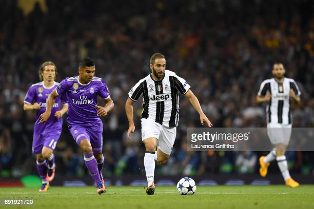 Gonzalo Higuain of Juventus is put under pressure by Danilo of Real Madrid during the UEFA Champions League Final between Juventus and Real Madrid at...