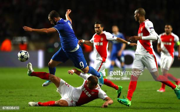Gonzalo Higuain of Juventus is tackled by Kamil Glik of AS Monaco during the UEFA Champions League Semi Final first leg match between AS Monaco v...
