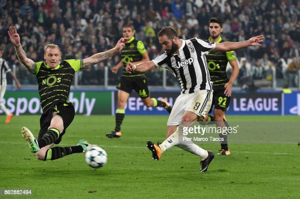 Gonzalo Higuain of Juventus shoots the ball during the UEFA Champions League group D match between Juventus and Sporting CP at Juventus Stadium on...