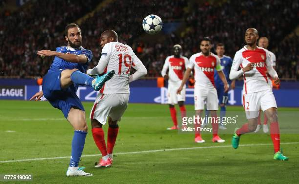 Gonzalo Higuain of Juventus takes a shot on goal during the UEFA Champions League Semi Final first leg match between AS Monaco v Juventus at Stade...