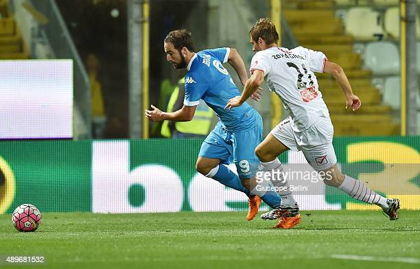 Gonzalo Higuain of Napoli and Simone Romagnoli of Carpi in action during the Serie A match between Carpi FC and SSC Napoli at Alberto Braglia Stadium...
