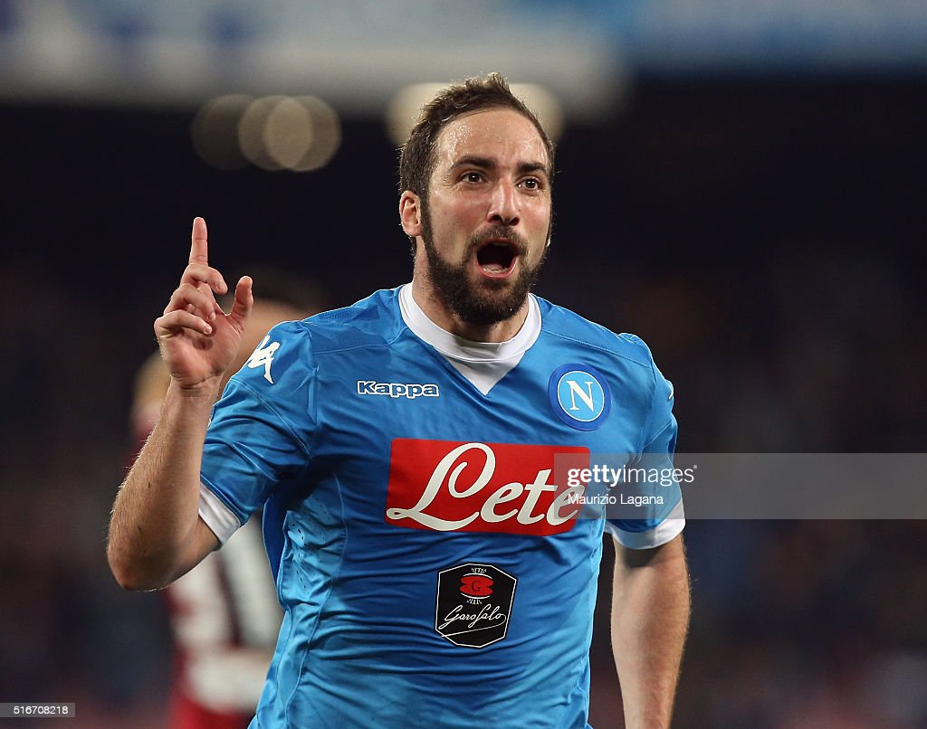 <a gi-track='captionPersonalityLinkClicked' href=/galleries/search?phrase=Gonzalo+Higuain&family=editorial&specificpeople=651523 ng-click='$event.stopPropagation()'>Gonzalo Higuain</a> of Napoli celebrates after scoring his team's second goal during the Serie A match between SSC Napoli and Genoa CFC at Stadio San Paolo on March 20, 2016 in Naples, Italy.