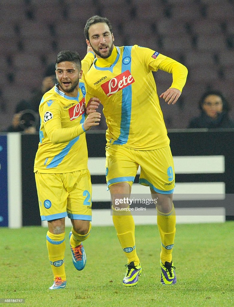 <a gi-track='captionPersonalityLinkClicked' href=/galleries/search?phrase=Gonzalo+Higuain&family=editorial&specificpeople=651523 ng-click='$event.stopPropagation()'>Gonzalo Higuain</a> (R) of Napoli celebrates after scoring the opening goal the UEFA Champions League Group F match between SSC Napoli and Arsenal at Stadio San Paolo on December 11, 2013 in Naples, Italy.