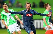 Gonzalo Higuain of Napoli celebrates as he scores their first goal during the UEFA Europa League Quarter Final first leg match between VfL Wolfsburg...
