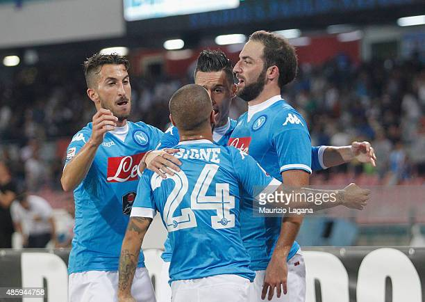 Gonzalo Higuain of Napoli celebrates the opening goal during the Serie A match between SSC Napoli and UC Sampdoria at Stadio San Paolo on August 30...