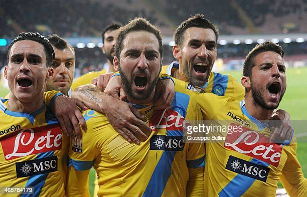 Gonzalo Higuain of Napoli celebrates with teammates after scoring the opening goal during the TIM Cup match between SSC Napoli and SS Lazio at Stadio...