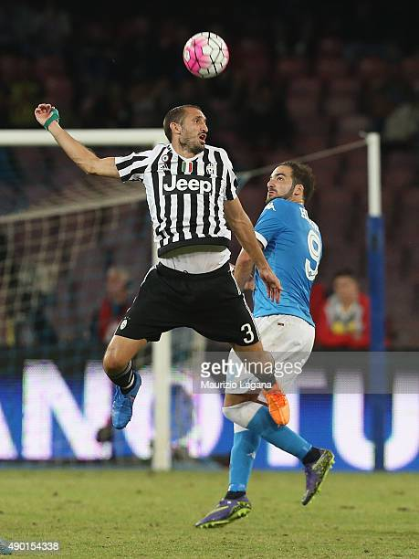 Gonzalo Higuain of Napoli competes for the ball in air with Giorgio Chiellini of Juventus during the Serie A match between SSC Napoli and Juventus FC...