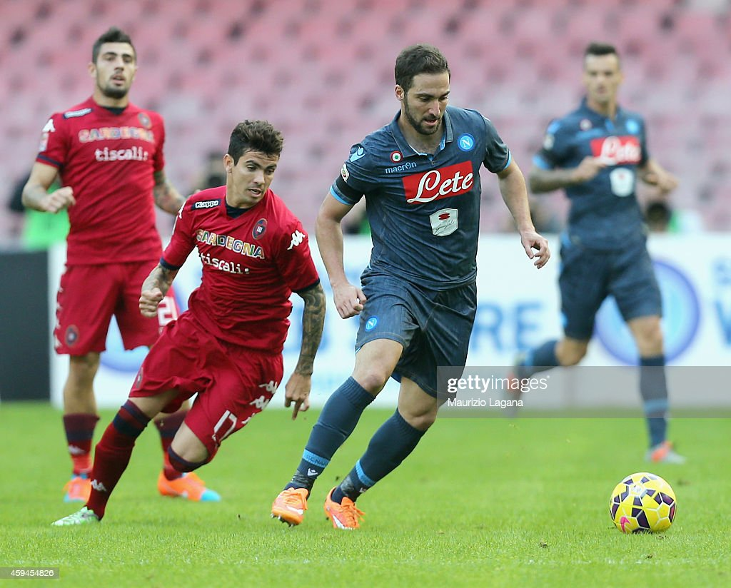 Gonzalo Higuain of Napoli competes for the ball with Diego Farias of Cagliari during the Serie A match between SSC Napoli and Cagliari Calcio at...