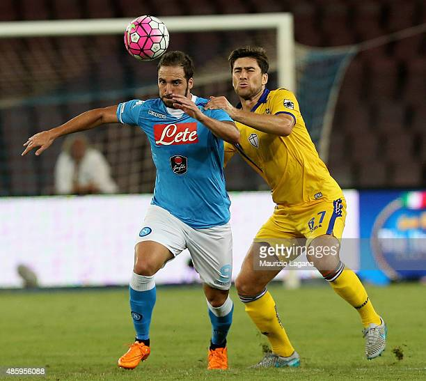 Gonzalo Higuain of Napoli competes for the ball with Ervin Zukanovic of Sampdoria during the Serie A match between SSC Napoli and UC Sampdoria at...