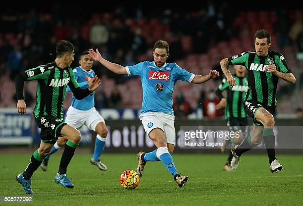 Gonzalo Higuain of Napoli competes for the ball with Federico Peluso and Francesco Acerbi of Sassuolo during the Serie A match between SSC Napoli and...
