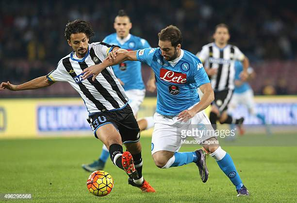 Gonzalo Higuain of Napoli competes for the ball with Felipe of Udinese during the Serie A match between SSC Napoli and Udinese Calcio at Stadio San...